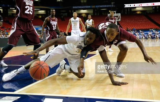 James Siakam of the Vanderbilt Commodores battles for a rebound against Craig Sword of the Mississippi State Bulldogs during the first round of the...