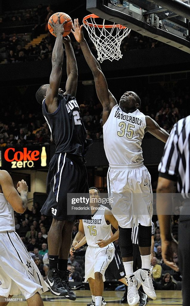 James Siakam #35 of the Vanderbilt Commodores tries to block a dunk by Roosevelt Jones #21 of the Butler Bulldogs at Memorial Gym on December 29, 2012 in Nashville, Tennessee.