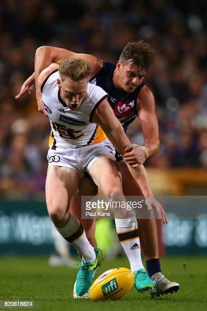 James Sicily of the Hawks and Nick Suban of the Dockers contest for the ball during the round 18 AFL match between the Fremantle Dockers and the...