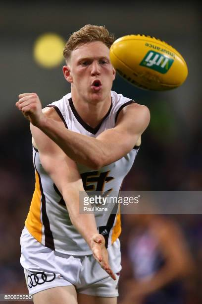 James Sicily of the Hawks handballs during the round 18 AFL match between the Fremantle Dockers and the Hawthorn Hawks at Domain Stadium on July 22...