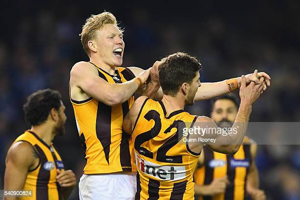 James Sicily of the Hawks is congratulated by Luke Breust after kicking a goal during the round 13 AFL match between the North Melbourne Kangaroos...