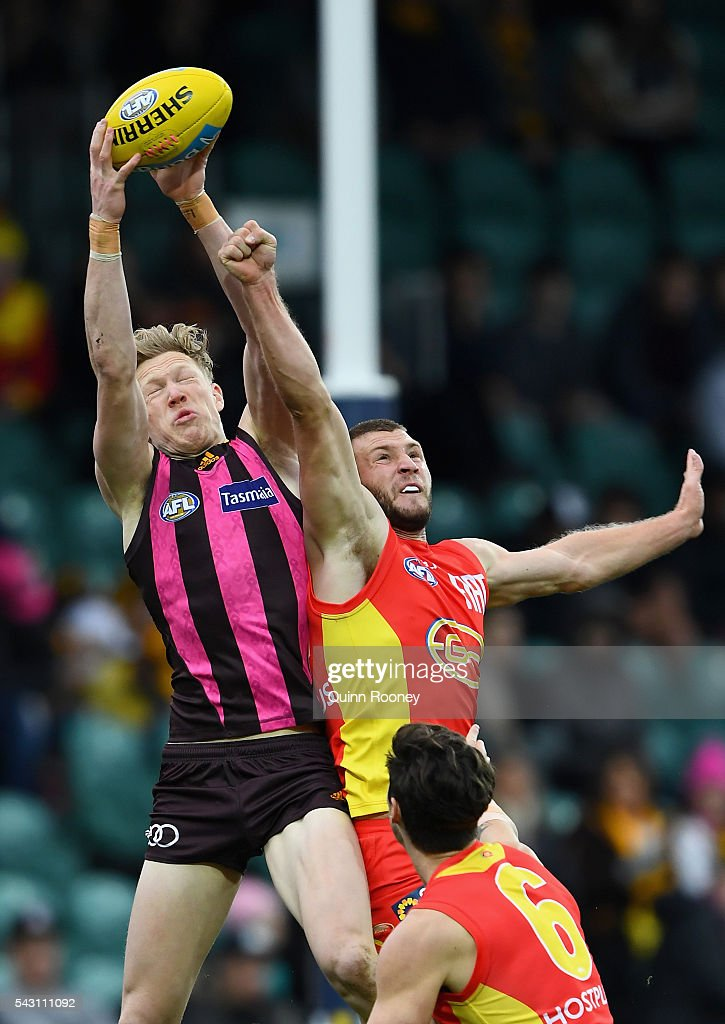 James Sicily of the Hawks marks over the top of Steven May of the Suns during the round 14 AFL match between the Hawthorn Hawks and the Gold Coast Suns at Aurora Stadium on June 26, 2016 in Launceston, Australia.