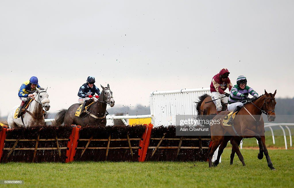 James Slevin riding Count Guido Deiro (R) clear the last to win The Betfair Acca Edge handicap Hurdle Race at Newbury racecourse on February 13, 2016 in Newbury, England.