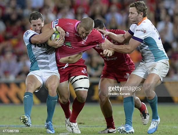 James Slipper of the Reds attempts to break through the defence during the round four Super Rugby match between Queensland Reds and the Cheetahs at...