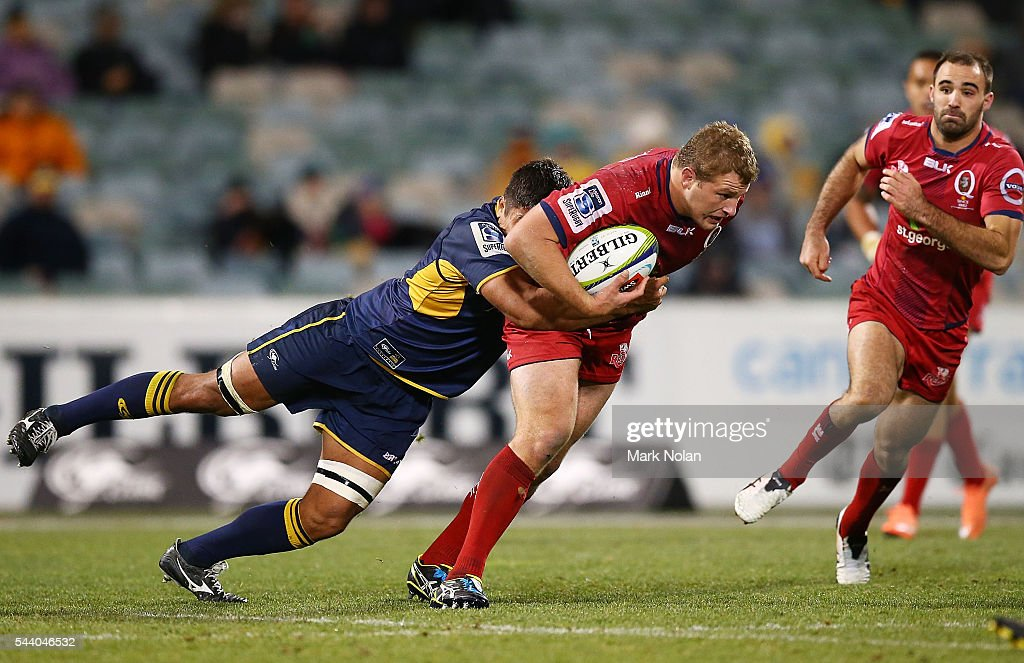 <a gi-track='captionPersonalityLinkClicked' href=/galleries/search?phrase=James+Slipper&family=editorial&specificpeople=6387734 ng-click='$event.stopPropagation()'>James Slipper</a> of the Reds is tackled during the round 15 Super Rugby match between the Brumbies and the Reds at GIO Stadium on July 1, 2016 in Canberra, Australia.