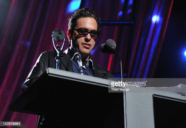 James Slovak accepts an award on behalf of his brother Hillel Slovak performs on stage during the 27th Annual Rock And Roll Hall Of Fame Induction...