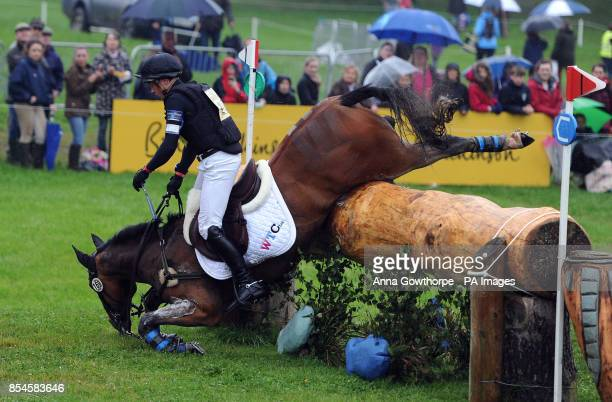 James Sommerville falls from his horse Talent as they compete in the CIC3* cross country event during the Bramham International Horse Trials at...