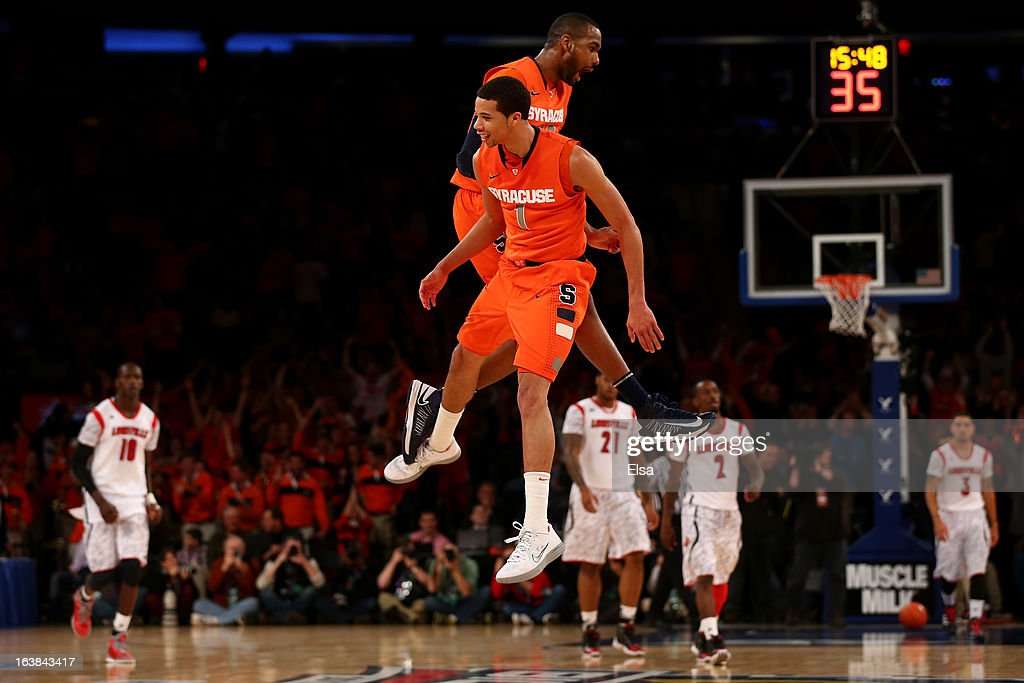 James Southerland #43 and <a gi-track='captionPersonalityLinkClicked' href=/galleries/search?phrase=Michael+Carter-Williams&family=editorial&specificpeople=7621167 ng-click='$event.stopPropagation()'>Michael Carter-Williams</a> #1 of the Syracuse Orange celebrate a play in the second half against the Louisville Cardinals during the final of the Big East Men's Basketball Tournament at Madison Square Garden on March 16, 2013 in New York City.