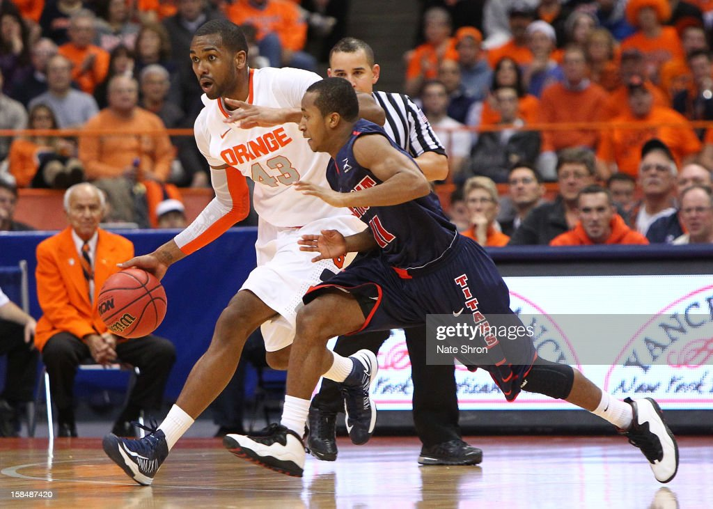 James Southerland #43 of the Syracuse Orange drives the ball down the court against P.J. Boutte #11 of the Detroit Titans during the game at the Carrier Dome on December 17, 2012 in Syracuse, New York.