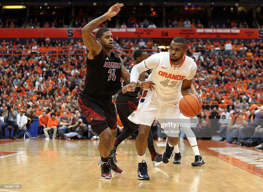 James Southerland #43 of the Syracuse Orange drives to the basket against Chane Behanan #21 of the Louisville Cardinals during the game at the Carrier Dome on March 2, 2013 in Syracuse, New York.