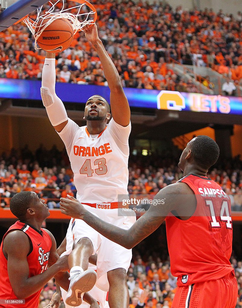 James Southerland #43 of the Syracuse Orange dunks the ball against Chris Obekpa #12 and Jakarr Sampson #14 of the St. John's Red Storm during the game at the Carrier Dome on February 10, 2013 in Syracuse, New York.