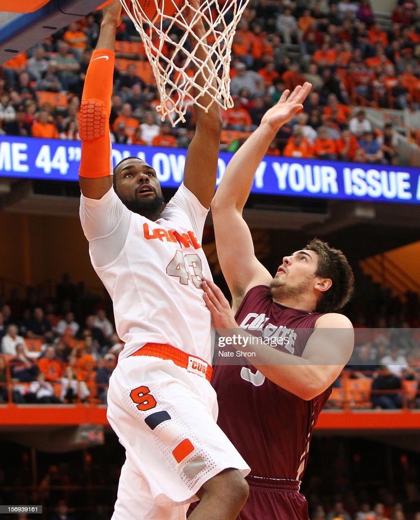 James Southerland #43 of the Syracuse Orange puts the ball up to the basket against John Brandenburg #3 of the Colgate Raiders during the game at the Carrier Dome on November 25, 2012 in Syracuse, New York.