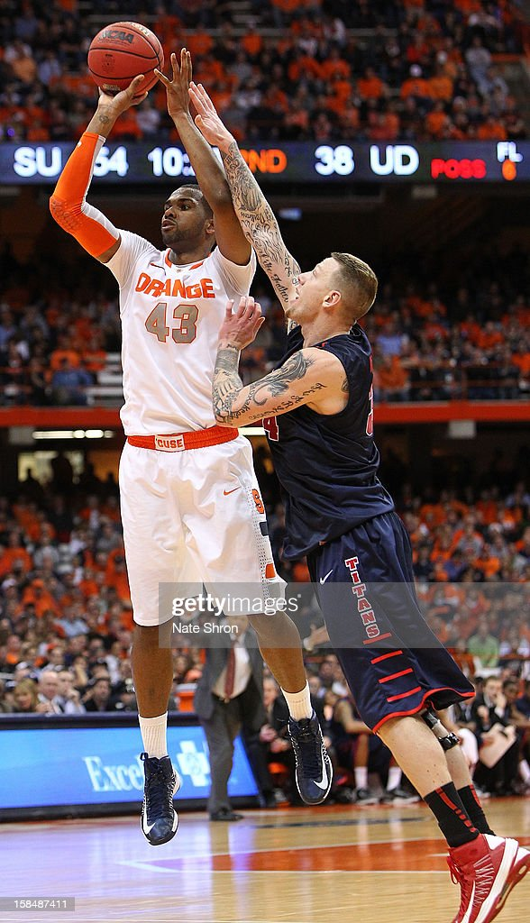 James Southerland #43 of the Syracuse Orange shoots the ball against Nick Minnerath #34 of the Detroit Titans during the game at the Carrier Dome on December 17, 2012 in Syracuse, New York.