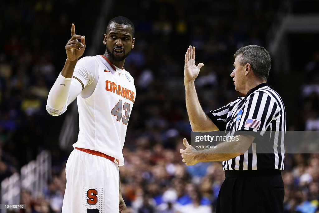James Southerland #43 of the Syracuse Orange speaks with an official after picking up his fourth foul against the California Golden Bears during the third round of the 2013 NCAA Men's Basketball Tournament at HP Pavilion on March 23, 2013 in San Jose, California.
