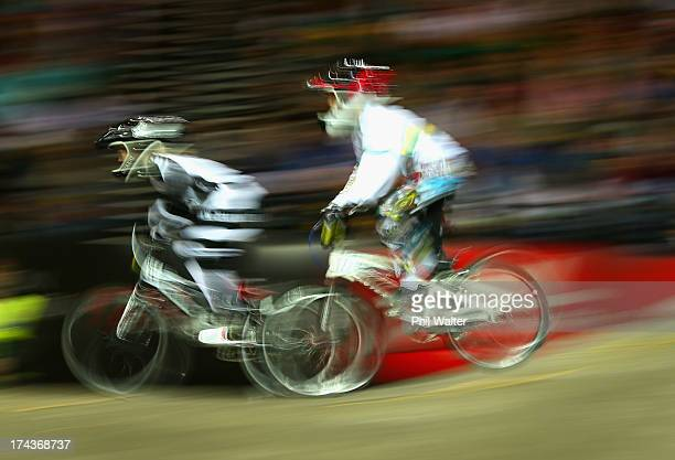 James Speedy of New Zealand and Regan Lothian of Australia compete in the 9 yr old boys during day two of the UCI BMX World Championships at Vector...