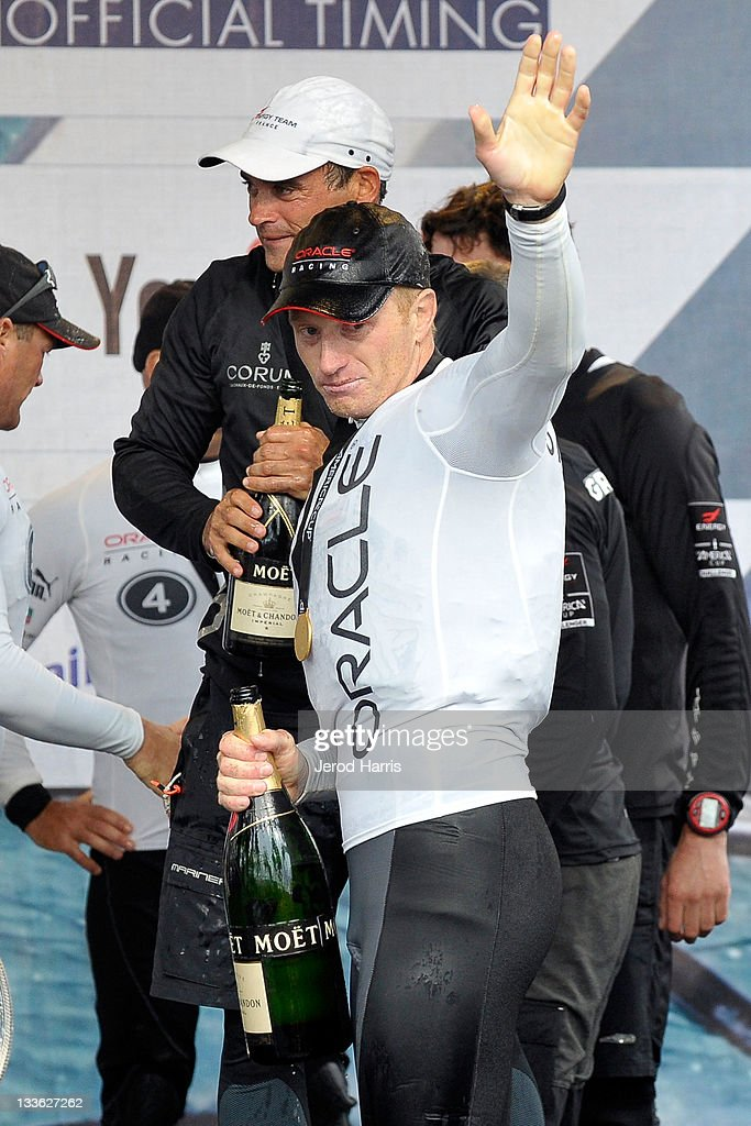 James Spithill skipper of Oracle Racing Coutts celebrates winning the America's Cup 500 Speed Trials with a traditional jerobaum of Moet Chandon on...