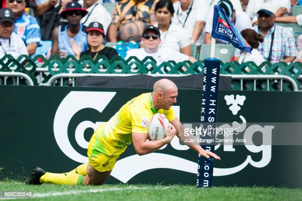 James Stannard of Australia dives over to a try during the 2017 Hong Kong Sevens match between Australia and South Korea at Hong Kong Stadium on...
