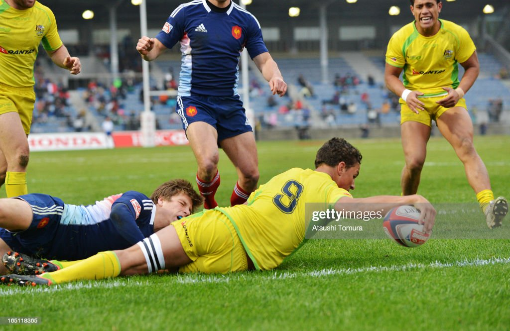 James Stannard of Australia reaches out to score a try during the match against France on day two of the HSBC Sevens Tokyo at Prince Chichibu Stadium on March 31, 2013 in Tokyo, Japan.