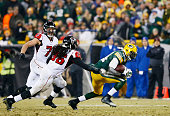 James Starks of the Green Bay Packers breaks the tackle of Kemal Ishmael and Kroy Biermann of the Atlanta Falcons in the third quarter at Lambeau...