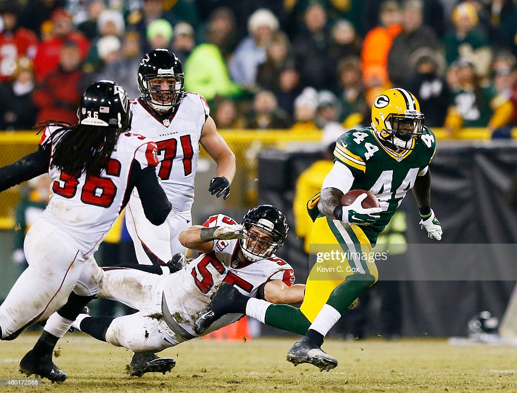 James Starks #44 of the Green Bay Packers breaks the tackle of Paul Worrilow #55 Kemal Ishmael #36 and Kroy Biermann #71 of the Atlanta Falcons in the third quarter at Lambeau Field on December 8, 2014 in Green Bay, Wisconsin.
