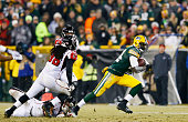 James Starks of the Green Bay Packers breaks the tackle of Paul Worrilow Kemal Ishmael and Kroy Biermann of the Atlanta Falcons in the third quarter...