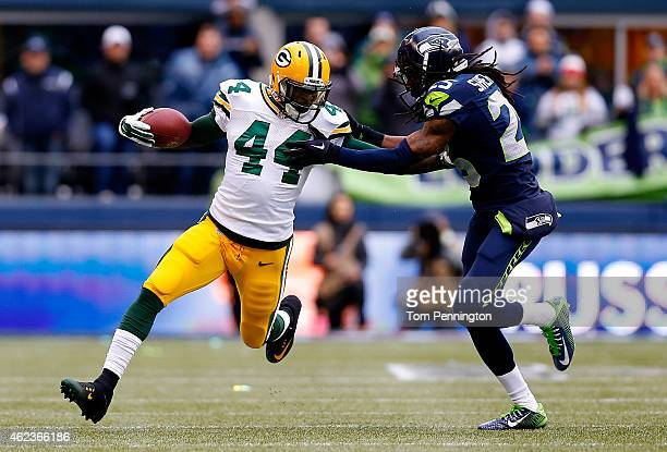 James Starks of the Green Bay Packers carries the ball as Richard Sherman of the Seattle Seahawks defends during the 2015 NFC Championship game at...