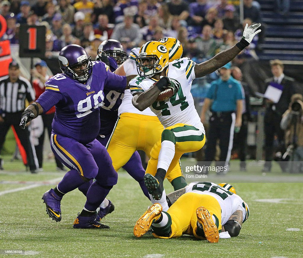 James Starks #44 of the Green Bay Packers carries the ball during an NFL game against the Minnesota Vikings at Mall of America Field at the Hubert H. Humphrey Metrodome on October 27, 2013 in Minneapolis, Minnesota.