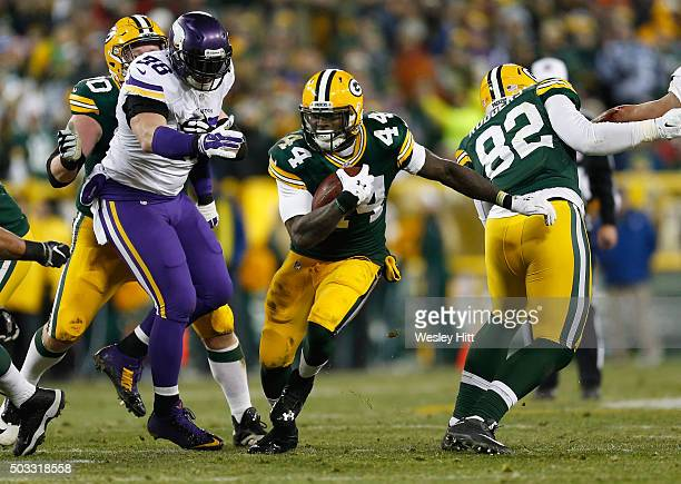 James Starks of the Green Bay Packers carries the ball during the second half against the Minnesota Vikings at Lambeau Field on January 3 2016 in...
