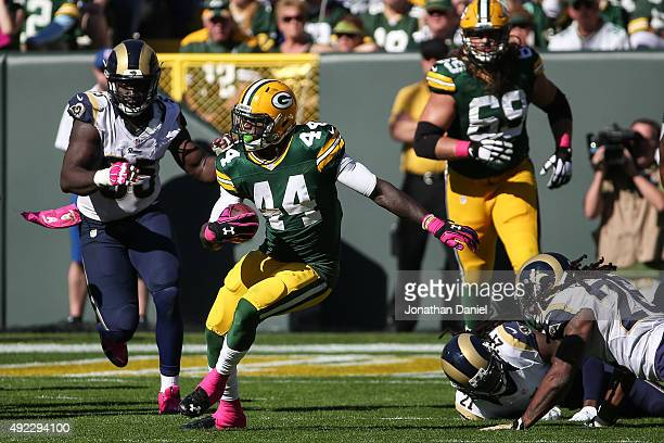 James Starks of the Green Bay Packers carries the football against the St Louis Rams in the third quarter at Lambeau Field on October 11 2015 in...