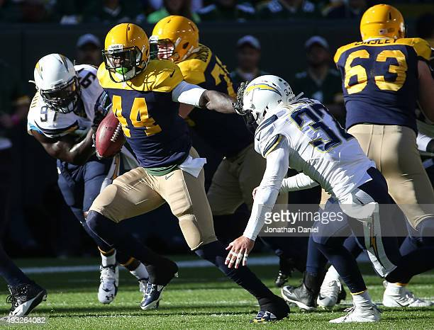 James Starks of the Green Bay Packers carries the football against Eric Weddle of the San Diego Chargers in the first quarter at Lambeau Field on...