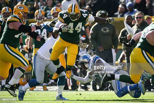 James Starks of the Green Bay Packers carries the football against Glover Quin of the Detroit Lions in the first quarter at Lambeau Field on November...