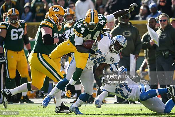 James Starks of the Green Bay Packers carries the football against Tahir Whitehead and Glover Quin of the Detroit Lions in the first quarter at...
