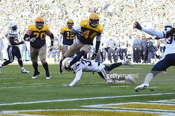 James Starks of the Green Bay Packers carries the football toward the endzone for a touchdown in the first quarter against the San Diego Chargers at...