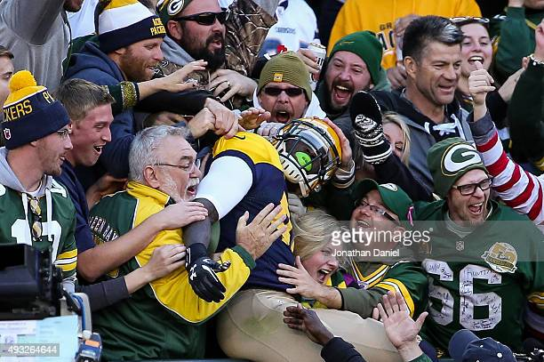 James Starks of the Green Bay Packers does the 'Lambeau Leap' after scoring his second touchdown in the first quarter against the San Diego Chargers...