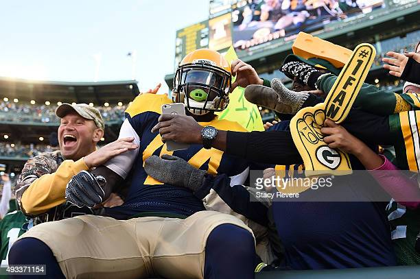 James Starks of the Green Bay Packers does the 'Lambeau Leap' following a touchdown during a game against the San Diego Chargers at Lambeau Field on...