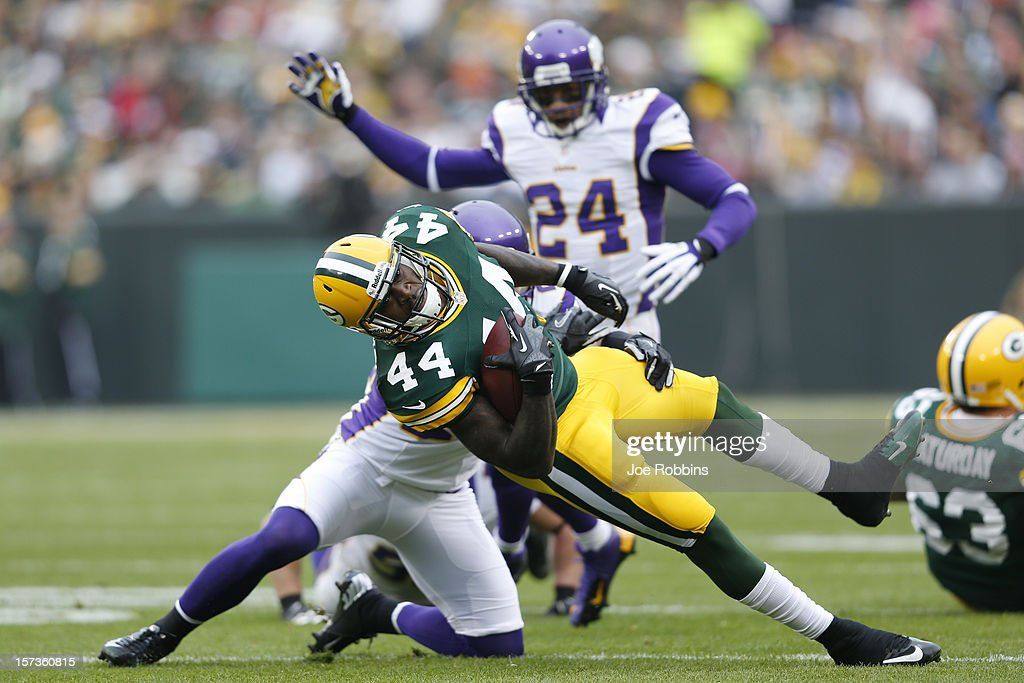James Starks #44 of the Green Bay Packers gets tackled while running with the ball against the Minnesota Vikings during the game at Lambeau Field on December 2, 2012 in Green Bay, Wisconsin. The Packers won 23-14.