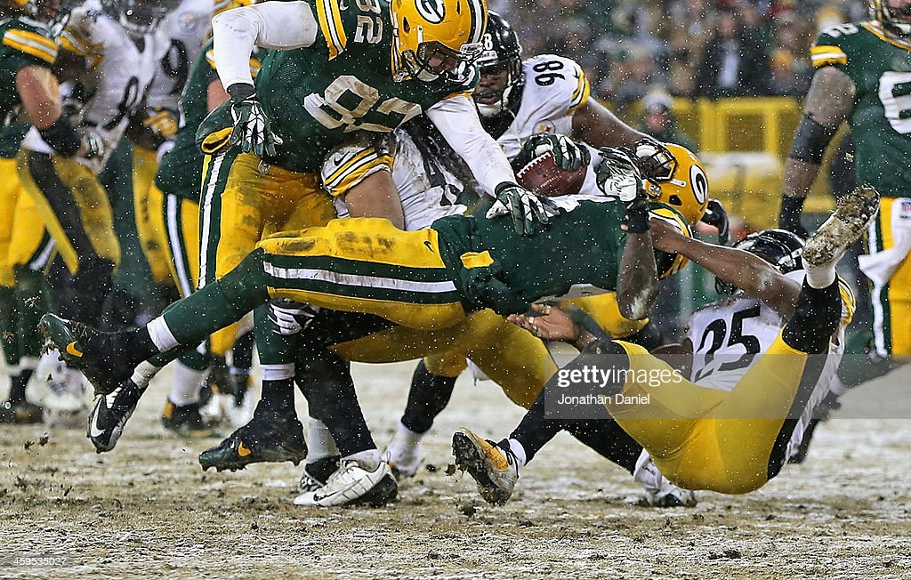 <a gi-track='captionPersonalityLinkClicked' href=/galleries/search?phrase=James+Starks&family=editorial&specificpeople=5441882 ng-click='$event.stopPropagation()'>James Starks</a> #44 of the Green Bay Packers is pulled down by Ryan Clark #25 of the Pittsburgh Steelers at Lambeau Field on December 22, 2013 in Green Bay, Wisconsin. The Steelers defeated the Packers 38-31.