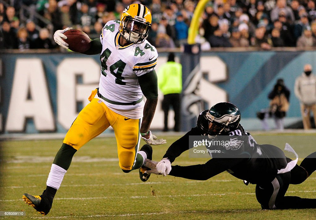 James Starks #44 of the Green Bay Packers outruns Marcus Smith #90 of the Philadelphia Eagles in the second half at Lincoln Financial Field on November 28, 2016 in Philadelphia, Pennsylvania. Green Bay won 27-13.