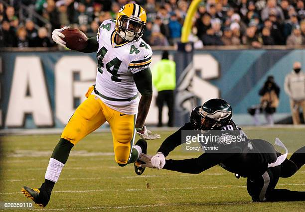 James Starks of the Green Bay Packers outruns Marcus Smith of the Philadelphia Eagles in the second half at Lincoln Financial Field on November 28...