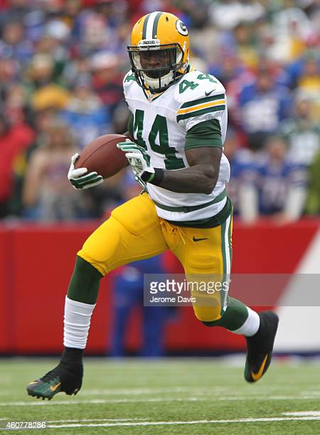 James Starks of the Green Bay Packers runs against the Buffalo Bills during the first half at Ralph Wilson Stadium on December 14 2014 in Orchard...