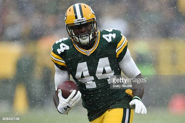 James Starks of the Green Bay Packers runs for yards during a game against the Houston Texans at Lambeau Field on December 4 2016 in Green Bay...