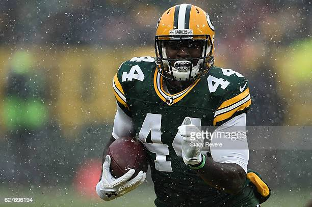 James Starks of the Green Bay Packers runs for yards during the first half of a game against the Houston Texans at Lambeau Field on December 4 2016...