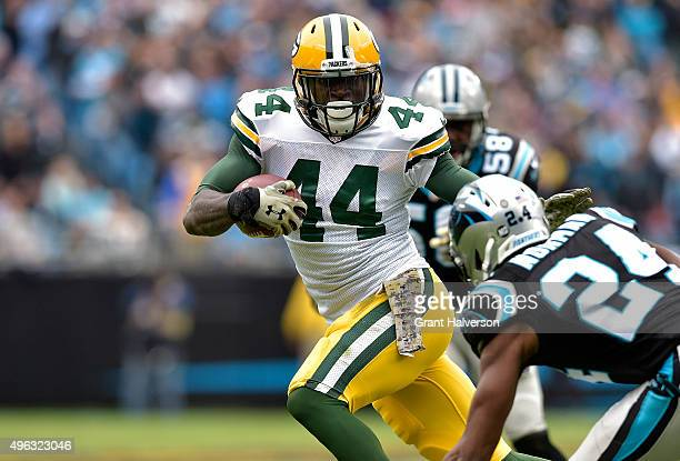 James Starks of the Green Bay Packers runs the ball against Josh Norman of the Carolina Panthers in the 3rd quarter during their game at Bank of...