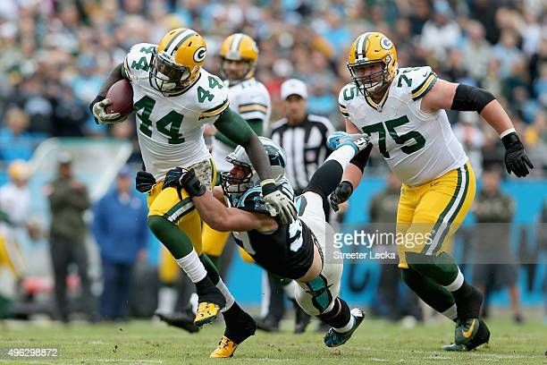 James Starks of the Green Bay Packers runs the ball against Luke Kuechly of the Carolina Panthers in the 1st quarter during their game at Bank of...