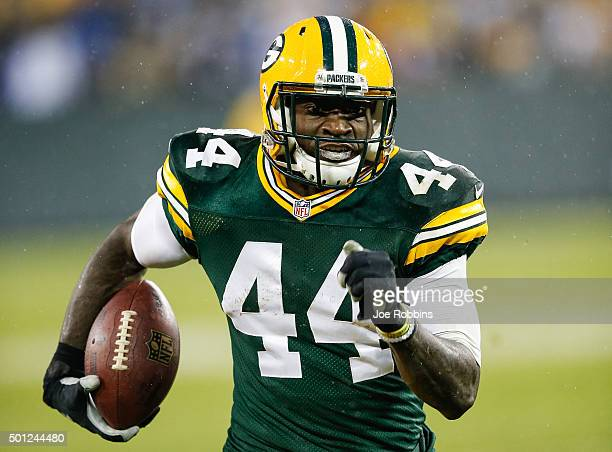 James Starks of the Green Bay Packers runs the football toward the endzone for a touchdown against the Dallas Cowboys in the second quarter at...