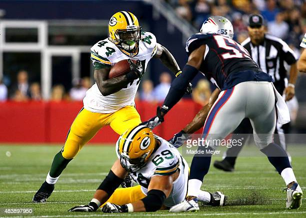 James Starks of the Green Bay Packers runs with the ball against Jonathan Freeny of the New England Patriots in the first half during a preseason...