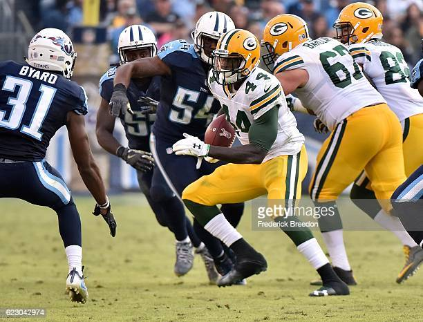 James Starks of the Green Bay Packers rushes against Kevin Byard of the Tennessee Titans during the second half at Nissan Stadium on November 13 2016...