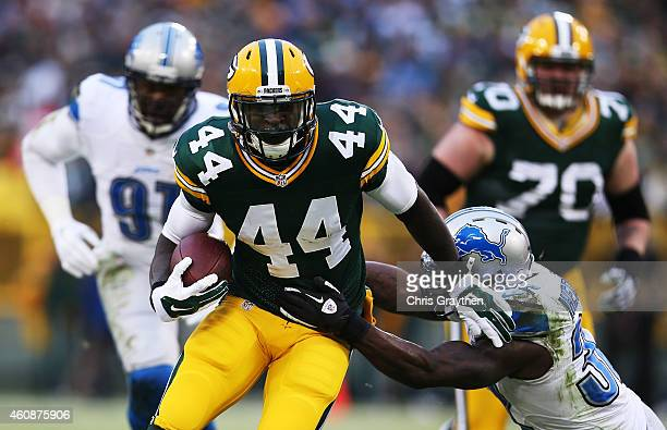 James Starks of the Green Bay Packers tries to avoid the tackle of James Ihedigbo of the Detroit Lions in the first quarter at Lambeau Field on...