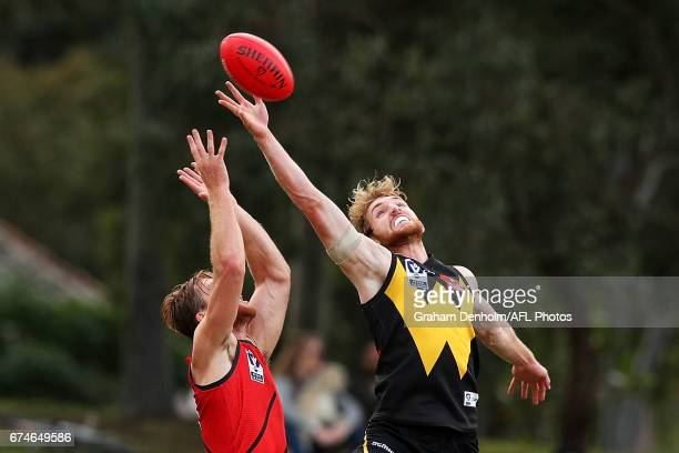 James Stewart of Essendon and Daniel Nielson of Werribee compete in the air during the round three VFL match between Werribee and Essendon at North...