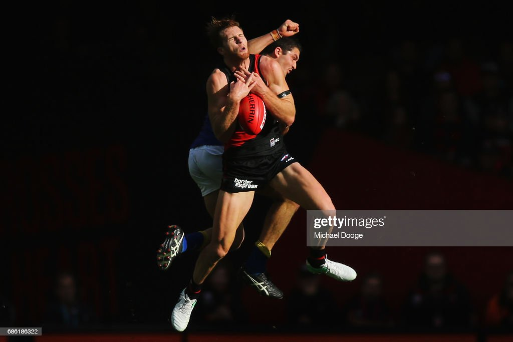 James Stewart of the Bombers compete for the ball in front of Tom Barrass of the Eagles during the round nine AFL match between the Essendon Bombers and the West Coast Eagles at Etihad Stadium on May 21, 2017 in Melbourne, Australia.